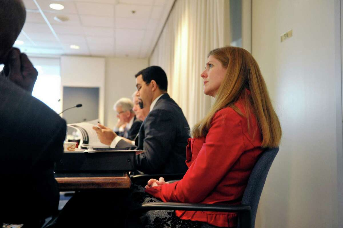 Beth Berlin, foreground, and New York State Education Commissioner, John King, center, take part in a Board of Regents meeting at the State Education building on Monday, Dec. 15, 2014, in Albany, N.Y. Berlin will serve as interim commissioner when King steps down. (Paul Buckowski / Times Union)
