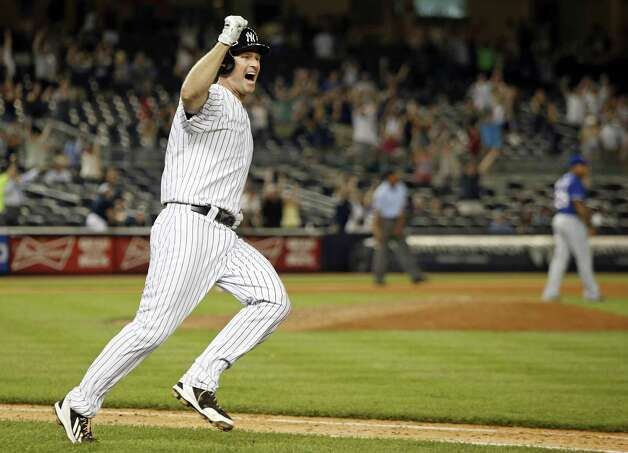 FILE - In this July 23, 2014, file photo, New York Yankees Chase Headley celebrates as he runs to first base after hitting a game-winning, walk-off RBI single to lift the Yankees to a 14th inning, 2-1 victory over the Texas Rangers in a baseball game at Yankee Stadium in New York. Headley arrived in the Yankee Stadium dugout in the second inning of the game after being traded and flying to New York from Chicago. (AP Photo/File) ORG XMIT: NY157 Photo: Uncredited / AP