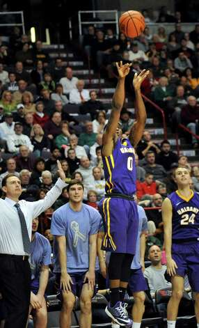 UAlbany's Evan Singletary, center, hits a three-pointer during their basketball game against Siena on Saturday Dec. 13, 2014, at Times Union Center in Albany, N.Y. (Cindy Schultz / Times Union) Photo: Cindy Schultz / 00029816A