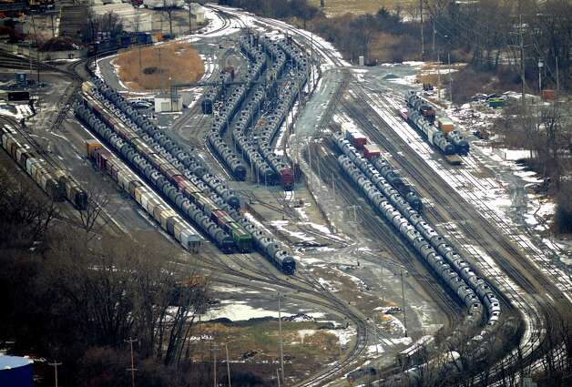 Oil tanker and freight cars at the Port of Albany are seen from Corning Tower Monday afternoon, Dec. 15, 2014, in Albany, N.Y. Speed limits for trains were lowered on tracks near a large industrial park near Voorheesville that are commonly used by massive trains carrying flammable crude oil after state and federal safety inspectors found a faulty switch that could have caused a derailment. (Will Waldron/Times Union) Photo: WW