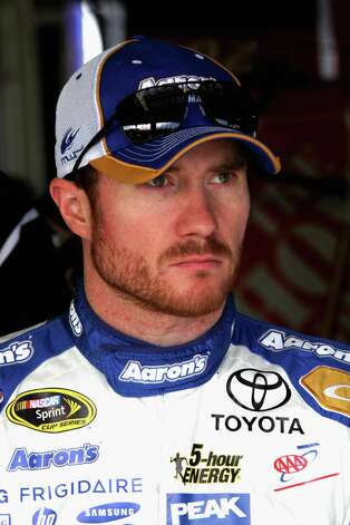 KANSAS CITY, KS - OCTOBER 04:  Brian Vickers, driver of the #55 Aaron's Dream Machine Toyota, stands in the garage during practice for the NASCAR Sprint Cup Series Hollywood Casino 400 at Kansas Speedway on October 4, 2014 in Kansas City, Kansas.  (Photo by Jerry Markland/Getty Images) ORG XMIT: 515972641 Photo: Jerry Markland / 2014 Getty Images