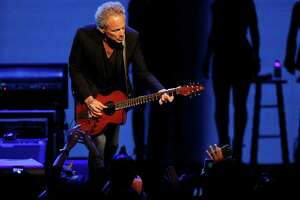 Lindsey Buckingham of Fleetwood Mac performs at the Toyota Center on Monday, Dec. 15, 2014, in Houston.
