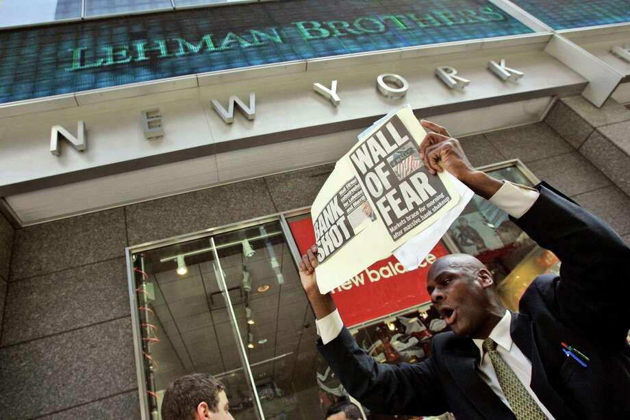 FILE - In this Sept. 15, 2008 file photo, a man demonstrates outside the Lehman Brothers headquarters in New York after the 158-year-old investment bank, choked by the credit crisis and falling real estate values, filed for Chapter 11 protection. Six years after the collapse of Lehman Bros., the lessons of the financial crisis may already be fading from memory. (AP Photo/Mary Altaffer, File) Photo: Mary Altaffer, STF / AP