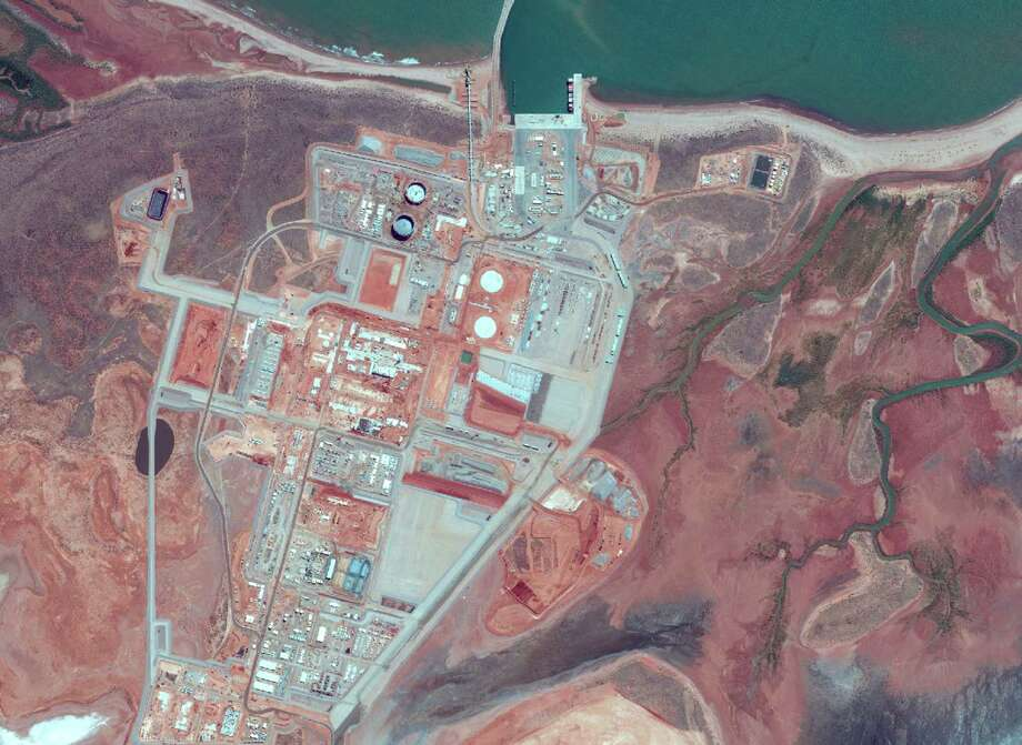 An aerial view shows the continuing construction on Chevron Corp.'s Wheatstone liquefied natural gas project in western Australia. Houston-based Apache Corp. said Dec. 15, 2014 that it is selling its 13 percent stake in the project. Photo: Chevron Corp.