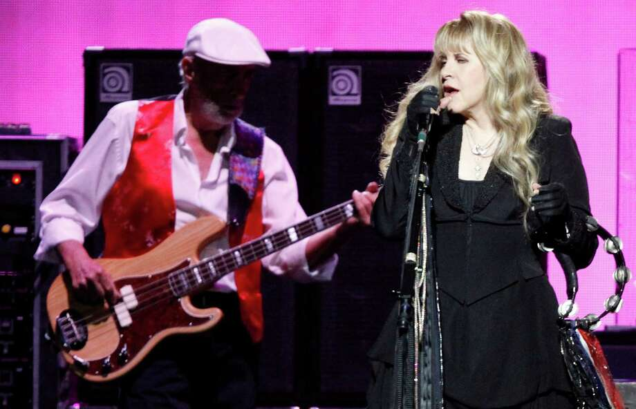 John McVie, left, and Stevie Nicks of Fleetwood Mac perform at the Toyota Center on Monday. Photo: J. Patric Schneider, Freelance / © 2014 Houston Chronicle