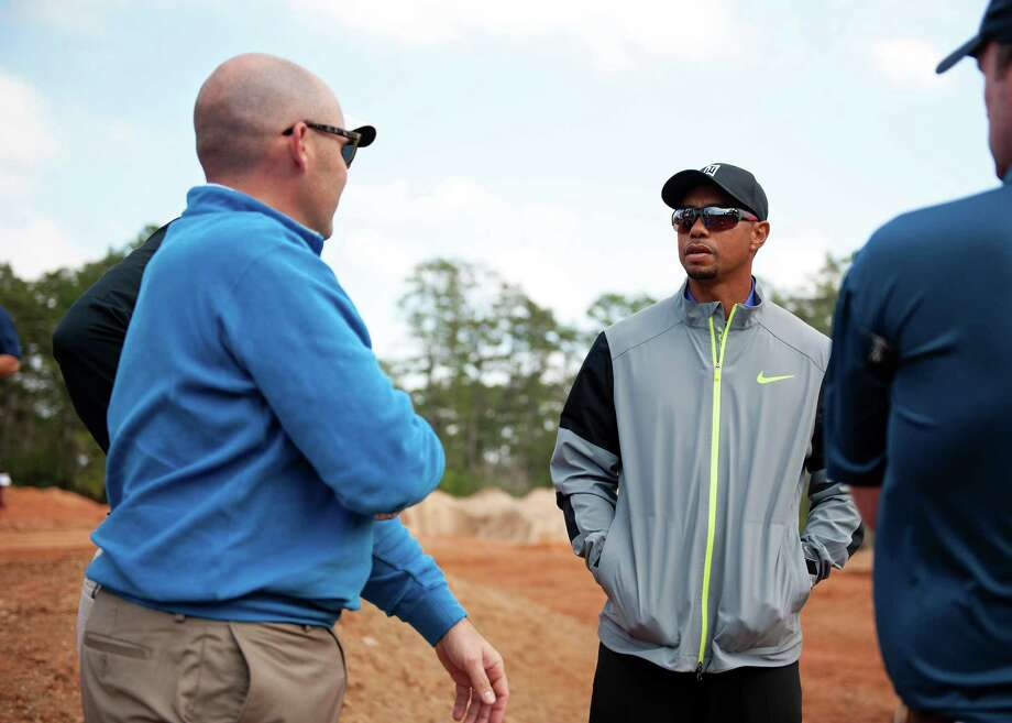 Club president Casey Paulson, left, and Tiger Woods check out the Bluejack National course being designed by Woods on Monday. Photo: Courtesy Of Bluejack National