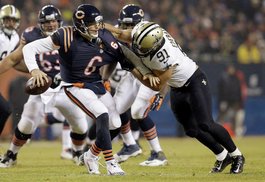 Saints linebacker Kasim Edebali grabs hold of Bears quarterback Jay Cutler, who was sacked seven times and threw three interceptions. Photo: Nam Y. Huh / Associated Press / AP