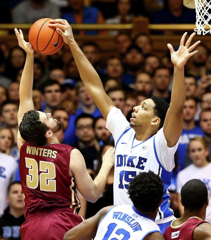Duke freshman Jahlil Okafor blocks the shot of Elon's Ryan Winters. Okafor had 25 points, 20 rebounds and three blocks. Photo: Streeter Lecka / Getty Images / 2014 Getty Images
