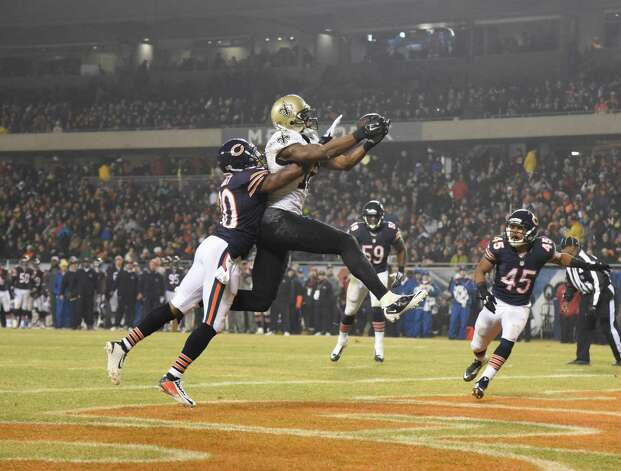 CHICAGO, IL - DECEMBER 15: Marques Colston #12 of the New Orleans Saints catches a touchdown in front of Demontre Hurst #30 of the Chicago Bears during the second quarter on December 15, 2014 at Soldier Field in Chicago, Illinois.   (Photo by David Banks/Getty Images) ORG XMIT: 507844377 Photo: David Banks / 2014 Getty Images