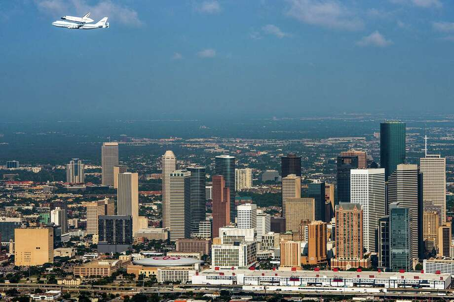 PHOTOS: The Space Shuttle program ends in 2011The space shuttle Endeavour, carried atop NASA's 747 Shuttle Carrier Aircraft, passes over the downtown Houston skyline during a flyover on Wednesday, Sept. 19, 2012. Endeavour stopped in Houston on its way from the Kennedy Space Center to the California Science Center in Los Angeles, where it will be placed on permanent display.Click through to see what the final days of the shuttle program looked like... Photo: Smiley N. Pool, Houston Chronicle / © 2012  Houston Chronicle