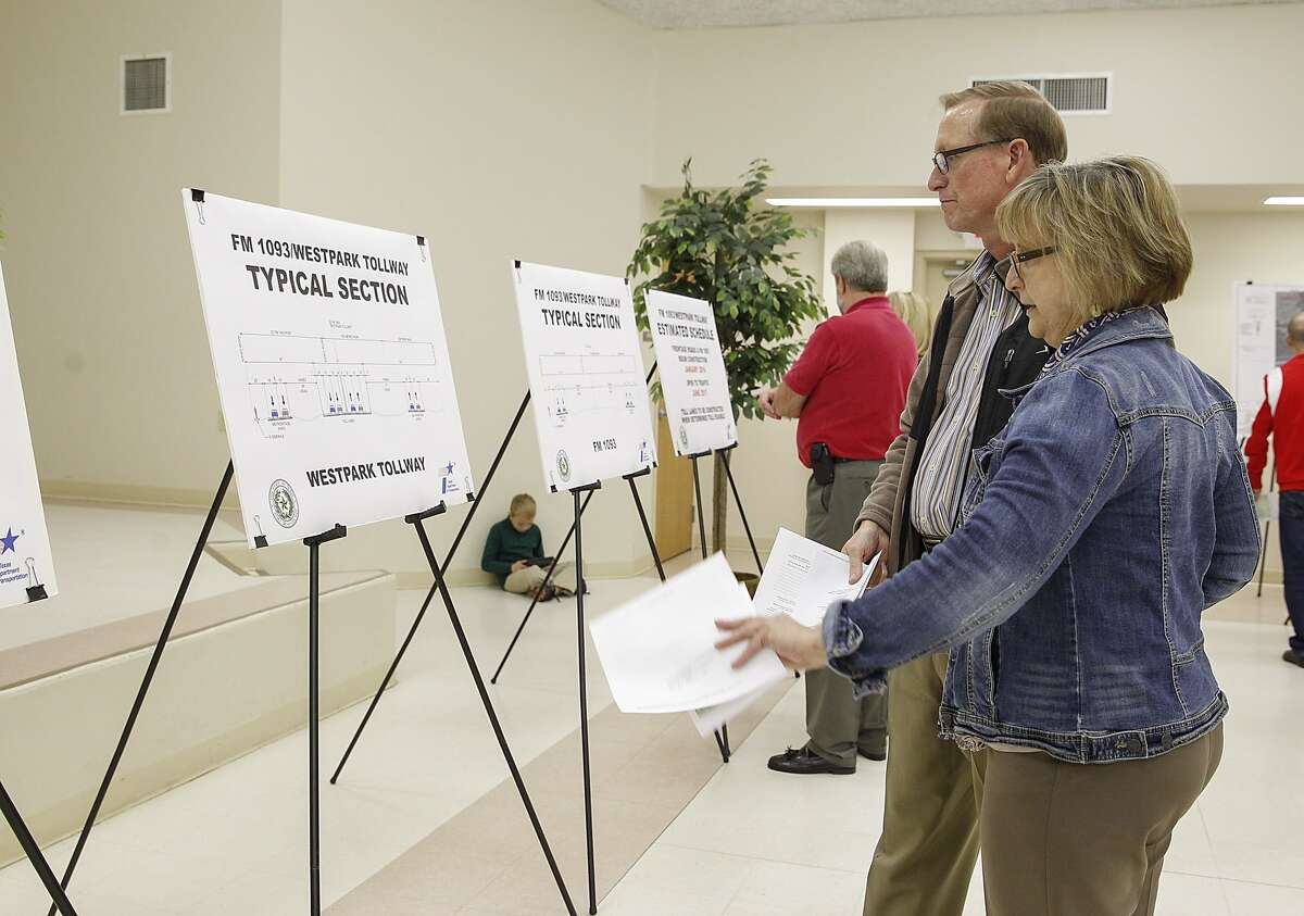 Debbie and David Crawford, who are building in the Fulbrook area,read displays about the expansion and widening of FM 1093 and the Westpark Tollway into Fulshearat an open house of the TxDOT Houston District, in partnership with Fort Bend County at the Stern Community Center in Fulshear on December 9, 2014.
