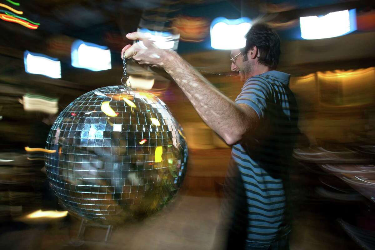 Dosey Doe owner Brad Said prepared for a previous New Year's Eve party by setting up a disco ball (Johnny Hanson/Chronicle)