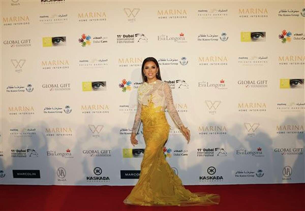 Eva Longoria arrives on the red carpet of the Global Gift Gala during day five of the 11th Annual Dubai International Film Festival at the Meydan Racecourse in Dubai, United Arab Emirates, Sunday, Dec. 14, 2014. (AP Photo/Kamran Jebreili)