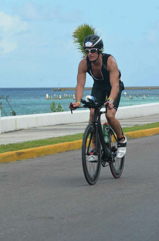 New Canaan, Conn., resident Bill Curcio rides his bike along Cozumel, an island off of the coast of Mexicoís Yucatan Peninsula, during the Ironman Cozumel triathlon race on Nov. 30, 2014. Photo: Contributed Photo, Contributed / New Canaan News Contributed