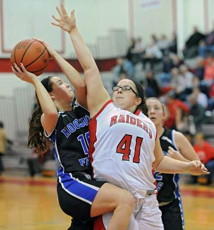 Hoosick Falls' Rachel Pine drives to the basket while guarded by Mechanicville's Kaile Kenyon, #41, during a basketball game on Monday, Dec. 15, 2014 in Mechanicville, N.Y. (Lori Van Buren / Times Union) Photo: Lori Van Buren, Albany Times Union / 00029856A