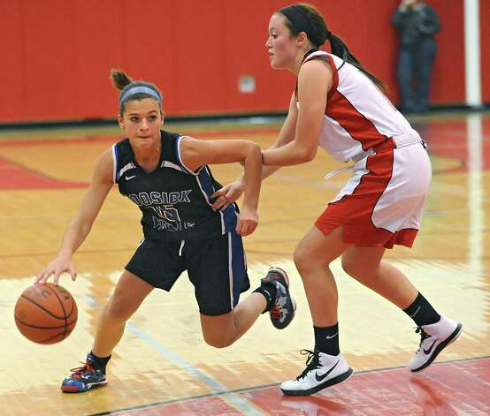 Hoosick Falls' Liz Ryan drives around Mechanicville's Julie Amodeo during a basketball game on Monday, Dec. 15, 2014 in Mechanicville, N.Y. (Lori Van Buren / Times Union) Photo: Lori Van Buren, Albany Times Union / 00029856A
