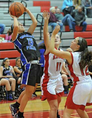 Hoosick Falls' Liz Ryan drives to the hoop while guarded by Mechanicville's Julie Amodeo and Courtney Pingelski, right, during a basketball game on Monday, Dec. 15, 2014 in Mechanicville, N.Y. (Lori Van Buren / Times Union) Photo: Lori Van Buren, Albany Times Union / 00029856A