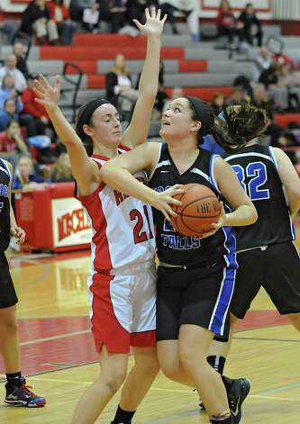 Hoosick Falls' Kelly Pine, right, drives to the hoop while guarded by Mechanicville's Courtney Pingelski during a basketball game on Monday, Dec. 15, 2014 in Mechanicville, N.Y. (Lori Van Buren / Times Union) Photo: Lori Van Buren, Albany Times Union / 00029856A