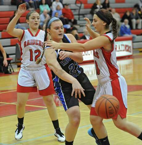 Hoosick Falls' Taylor Hayes passes the ball around Mechanicville's Kali DeMarco, right, during a basketball game on Monday, Dec. 15, 2014 in Mechanicville, N.Y. (Lori Van Buren / Times Union) Photo: Lori Van Buren, Albany Times Union / 00029856A