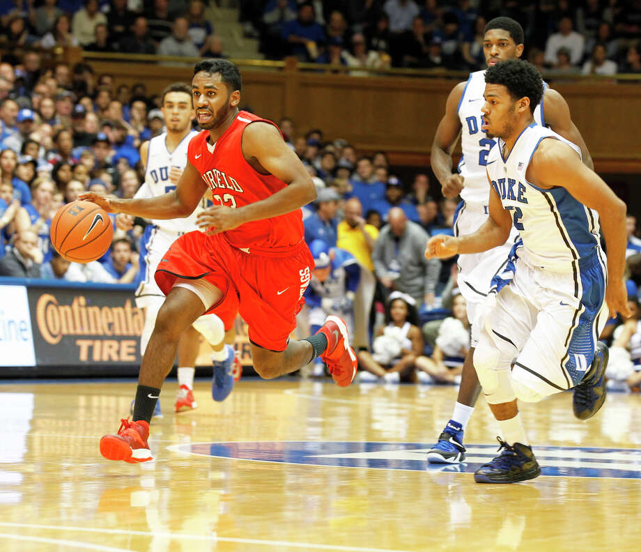 Fairfield University guard Steve Johnston, seen here handling the ball against Duke, proved his grit by working his way up from team manager to practice player to prime-time player. Photo: Fairfield Citizen/Contributed / Fairfield Citizen