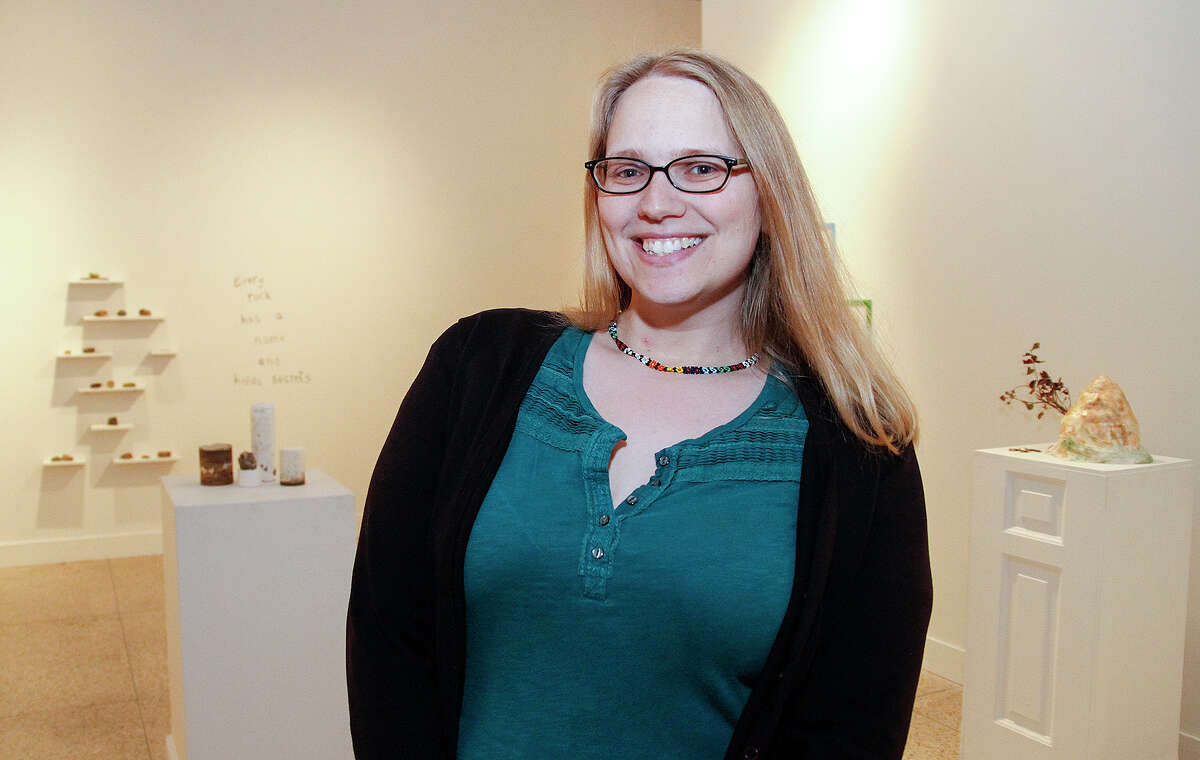 Nicole Geary stands with her work at the Guadalupe Cultural Arts Center, Thursday, Dec. 11, 2014. She is part of the center's new Artist Lab program which is hosting its inaugural exhibition, Friday, Dec. 12 through the end of January.