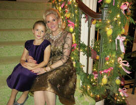 Daisy Traina celebrates the season with her grandmother, FAM board president Dede Wilsey.