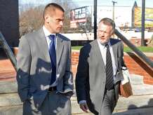 Kyle Seitz, left, leaves Danbury Superior Court Friday morning, Nov. 21, 2014, accompanied by his attorney John Gulash. Seitz, of Ridgefield, plead not guilty on the charge of negligent homicide in the death of his 15-month-old son Benjamin who died after being left in a hot car.