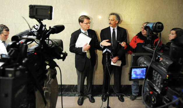 Blair Horner, center, and Russ Haven of NYPIRG release a report that examines 59 local governments decisions to support hydraulic fracturing on Tuesday Dec. 16, 2014, at the Capitol in Albany, N.Y. (Cindy Schultz / Times Union) Photo: Cindy Schultz, Albany Times Union / 00029874A
