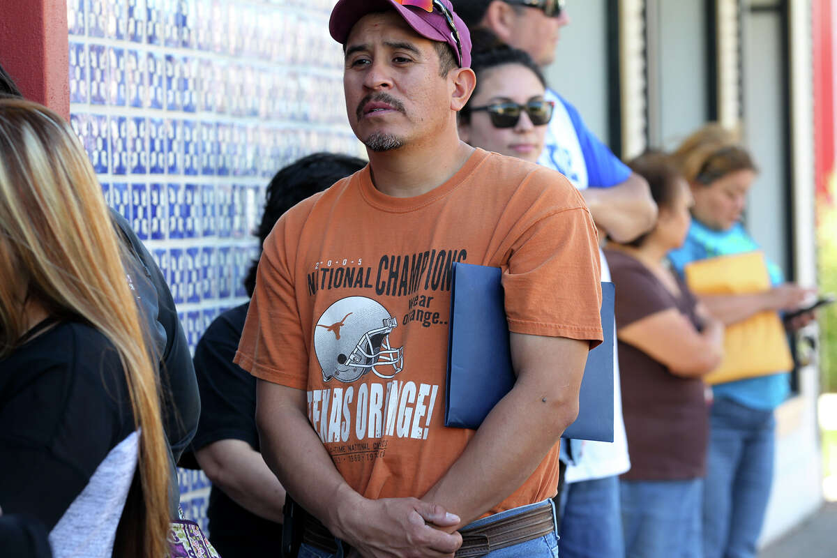 Oscar Soriano waits to sign up for health insurance during a December enrollment event at Progreso Hall on the city's West Side. Enrollments for the San Antonio and New Braunfels metropolitan statistical area totaled 89,821 people as of Jan. 30, according to the federal health agency.