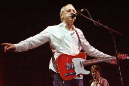 Former Dire Straits lead singer Mark Knopfler performs during a concert in the southern Indian city of Bangalore late March 7, 2005. Photo taken March 7, 2005. REUTERS/Jagadeesh Nv. HOUCHRON CAPTION (03/22/2005) SECBIZ: DIGITAL RECORDING: Singer and guitarist Mark Knopfler performs in Bangalore, India, earlier this month. Knopfler has an Advanced Micro Devices recording unit accompanying him on his world tour.