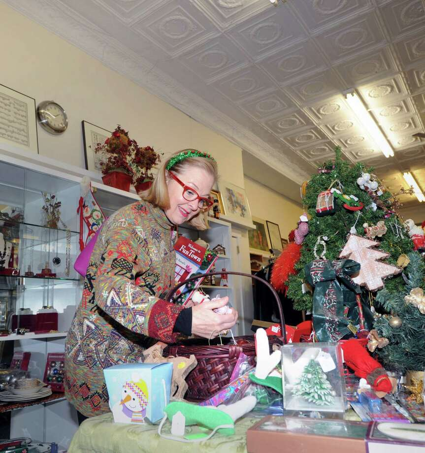 Moira Ward of Chickahominy shops at the Rummage Room at 191 Sound Beach Ave., Old Greenwich, Conn., Tuesday, Dec. 16, 2014. The store, operated by the WomenâÄôs Fellowship of the First Congregational Church in Old Greenwich, is celebrating its 50th anniversary. According to salesperson Judy Miller, the store donates its profits to women and children's groups in need. Photo: Bob Luckey / Greenwich Time