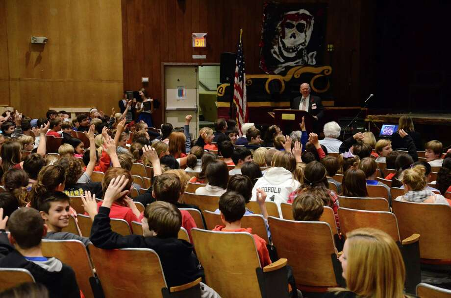 Peter Langenus, commander of New Canaan Post 653 of the Veterans of Foreign Wars, speaks during a Veterans Day ceremony at Saxe Middle School in New Canaan, Conn., Tuesday, Nov. 11, 2014. The auditorium has been closed to students this week after an environmental firm found PCBs in some of the paint systems. Photo: Nelson Oliveira / New Canaan News