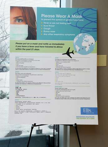A sign is displayed in the lobby of Ellis Medicine to ask patients or visitors to wear a mask if they show symptoms of the flu or ebola on Tuesday, Dec. 16, 2014 in Clifton Park, N.Y. (Lori Van Buren / Times Union) Photo: Lori Van Buren / 00029883A