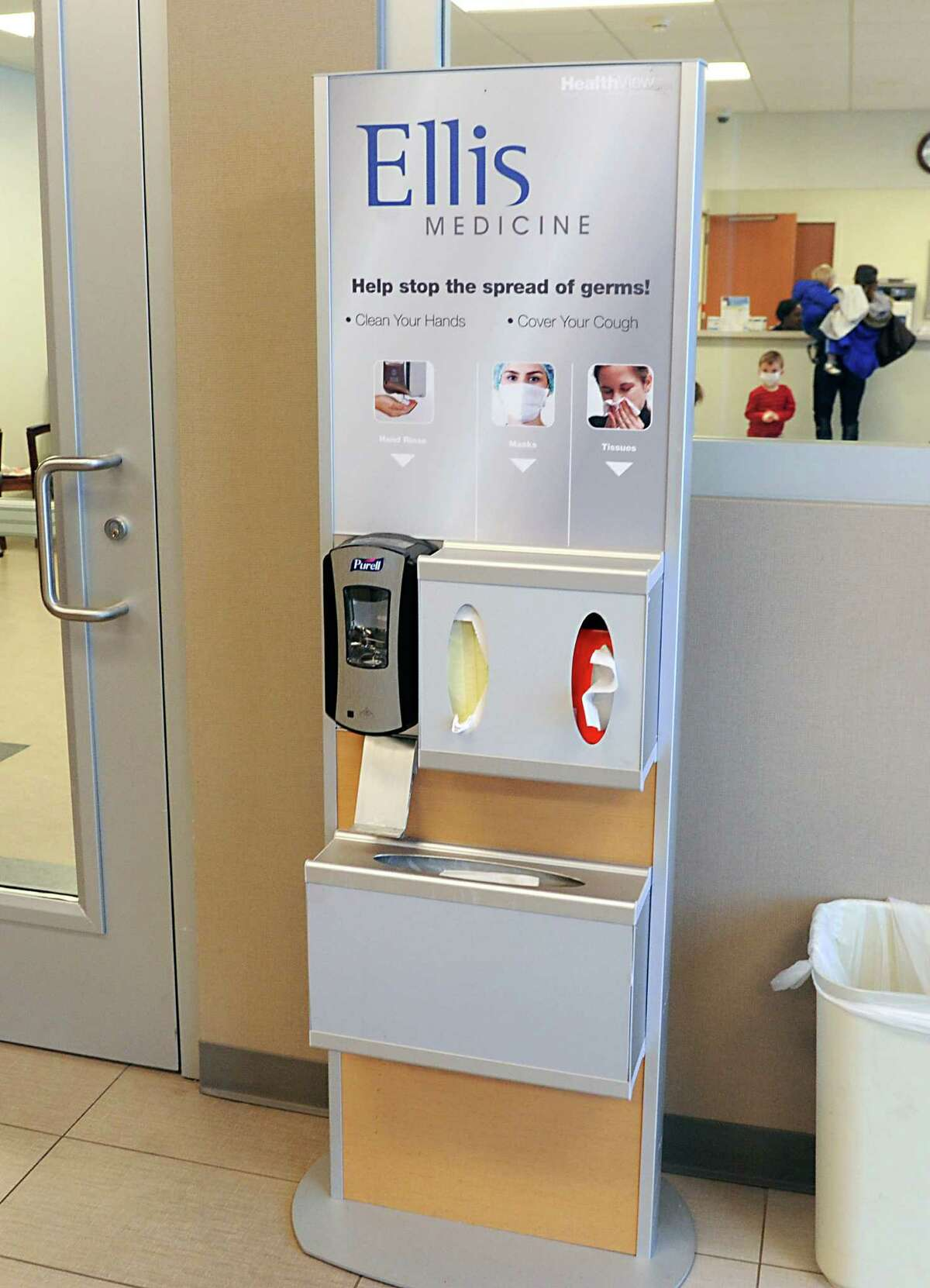 A kiosk which dispenses hand sanitizer, masks and tissue is seen in the lobby of Ellis Medicine on Tuesday, Dec. 16, 2014 in Clifton Park, N.Y. (Lori Van Buren / Times Union)