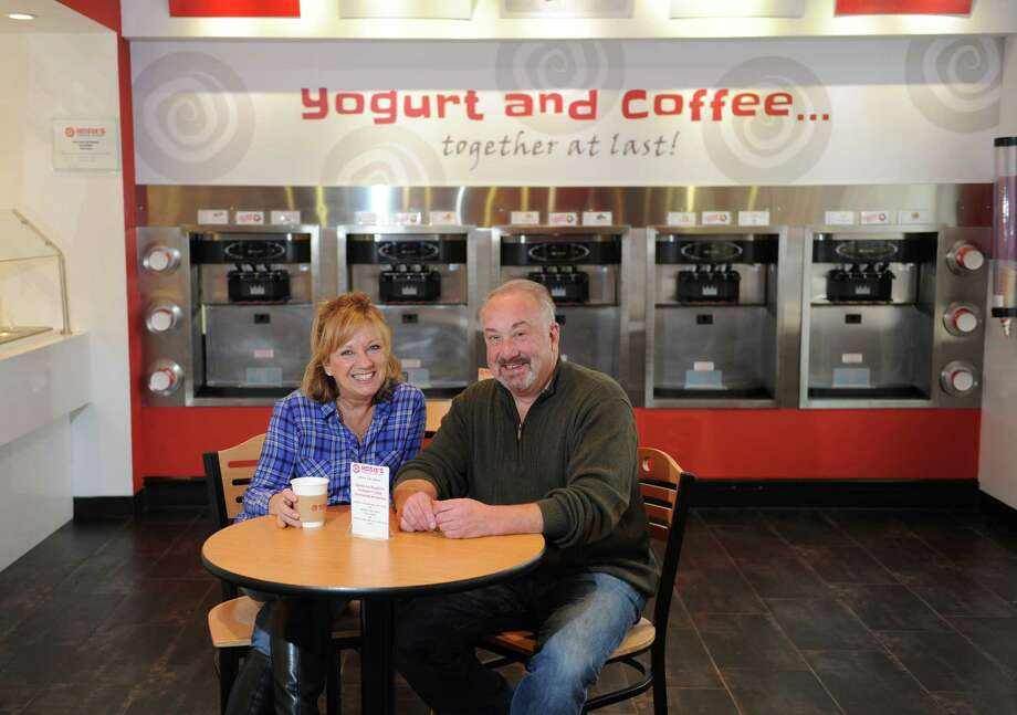 Co-owners Sindy and Steve Steinberg sit at a table inside Rosie's Frozen Yogurt in the Cos Cob section of Greenwich, Conn. Tuesday, Dec. 16, 2014.  The shop carries a variety of self-serve frozen yogurts and recently added a coffee bar that serves fresh-brewed coffee, tea, cappuccino, hot chocolate and espresso drinks. Photo: Tyler Sizemore / Greenwich Time