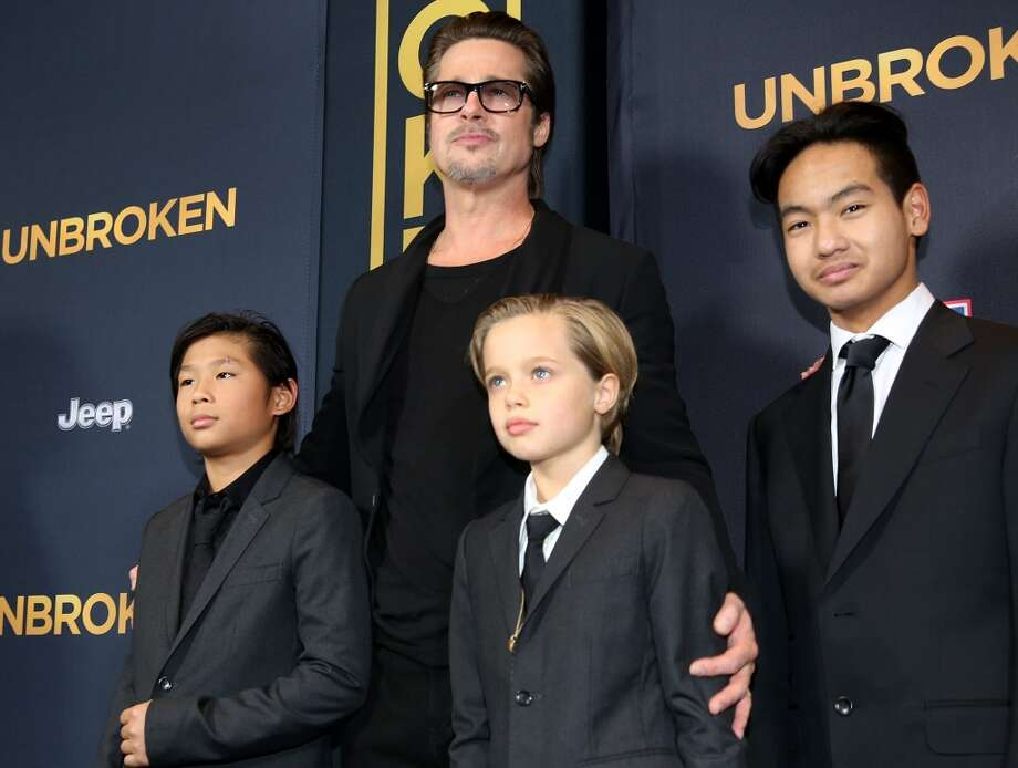 "Pax Jolie-Pitt, from left, Brad Pitt, Shiloh Jolie-Pitt and Maddox Jolie-Pitt arrive at the Los Angeles premiere of ""Unbroken"" at TCL Chinese Theatre on Monday, Dec. 15, 2014. Photo: Matt Sayles, Associated Press"