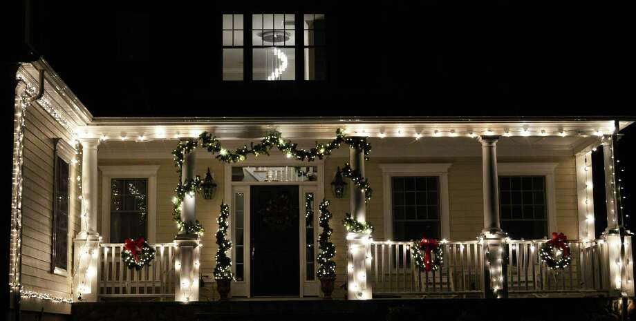 A Robin Hood Lane home is aglow with holiday warmth. Photo: Jarret Liotta / Darien News