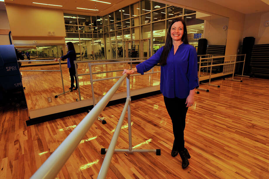 Executive Director Greta Wagner poses next to a ballet bar in the fitness center at Chelsea Piers Connecticut in Stamford, Conn., on Tuesday, Dec. 16, 2014. Chelsea Piers will soon be opening a Dance Academy with classes starting on January 12 aimed for students of all ages. Photo: Jason Rearick / Stamford Advocate