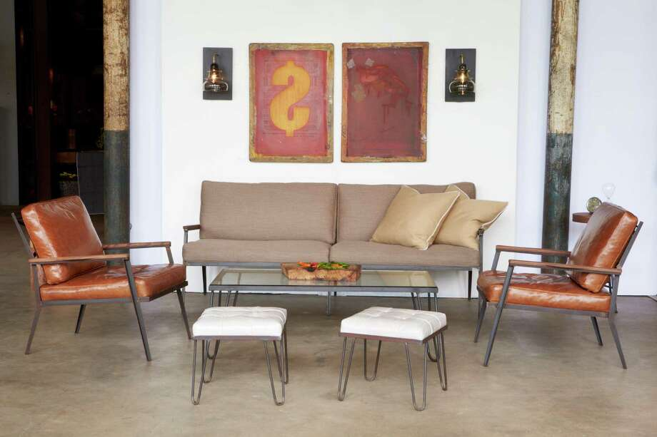 The Alcott sofa and chair and the Edwin coffee table and ottoman are part of Cisco Home's Mid Century line; Morse sconces are also shown. Photo: Cisco Home / ONLINE_YES