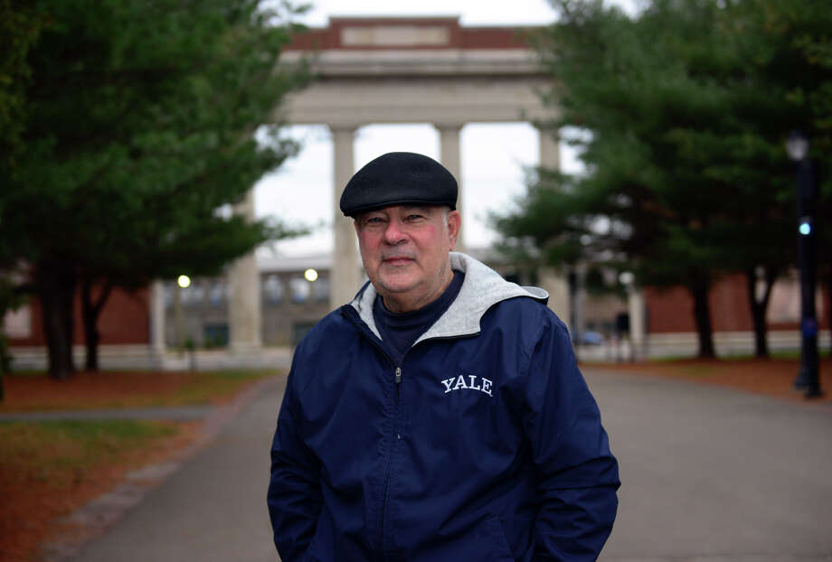 """Richard Marazzi stands near Yale Bowl's Walter Camp Field entrance in New Haven, Conn., on Tuesday Dec. 16, 2014. Marazzi has authored a coffee table book about the historic site called """"Bowlful of Memories."""" Photo: Christian Abraham / Connecticut Post"""