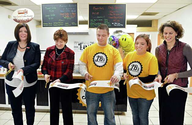 Cutting the ribbon for the new JBOs Capital Convenience store on South Pearl Street are, from left, BID executive director Georgette Steffens, Albany Mayor Kathy Sheehan, co-owners Joe Brown and Gabriela Rabelo-Brown and NYS Assembly member Patricia Fahy during grand opening ceremonies Tuesday Dec. 16, 2014, in Albany, NY.  (John Carl D'Annibale / Times Union) Photo: John Carl D'Annibale / 00029823A