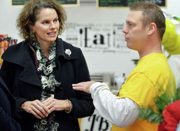 Assemblymember Patricia Fahy, left, with new store owner Joe Brown during JBOs Capital Convenience store on South Pearl Street's grand opening Tuesday Dec. 16, 2014, in Albany, NY.  (John Carl D'Annibale / Times Union) Photo: John Carl D'Annibale / 00029823A