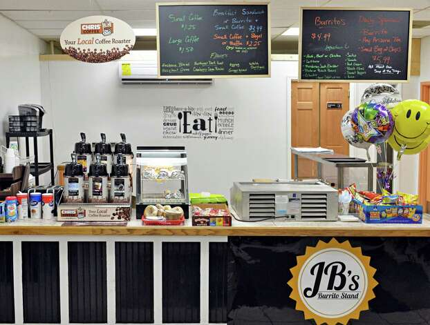 Food counter at Joe Brown and Gabriela Rabelo-Brown's new JBOs Capital Convenience store on South Pearl Street during its grand opening Tuesday Dec. 16, 2014, in Albany, NY.  (John Carl D'Annibale / Times Union) Photo: John Carl D'Annibale / 00029823A