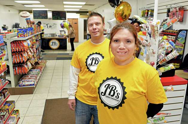 Co-owners Joe Brown and Gabriela Rabelo-Brown inside their new JBa€™s Capital Convenience store on South Pearl Street during its grand opening Tuesday Dec. 16, 2014, in Albany, NY.  (John Carl D'Annibale / Times Union) Photo: John Carl D'Annibale / 00029823A