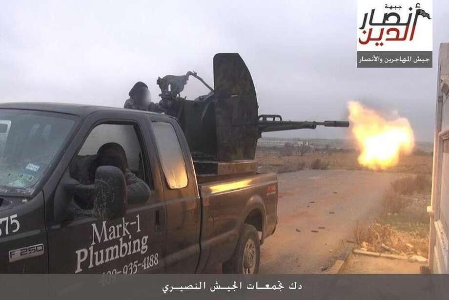A Texas City plumber says he is receiving threats after a photo of one of his old trucks was posted online showing the vehicle being used as a gun platform in the war in Syria.