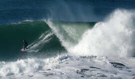 Big-wave surfer Bianca Valenti catches a wave off of San Francisco's Ocean Beach on Saturday.