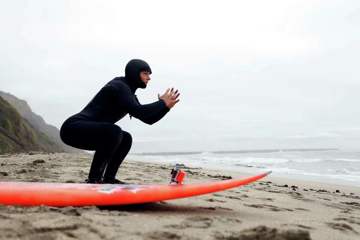 Bianca Valenti prepares to go big wave surfing on Maverick Beach in Half Moon Bay, Calif., on Tuesday, December 9, 2014.