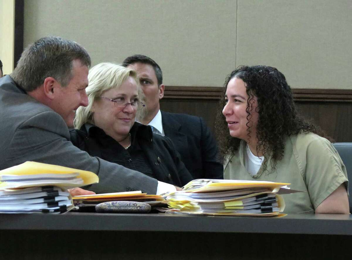Hannah Overton, right, confers with her attorneys, John Raley, left, and Cynthia Orr, during her bail hearing on Tuesday, Dec. 16, 2014 in Corpus Christi. Overton was convicted in 2007 in the death of a child and recently had her conviction overturned by the Texas Court of Criminal Appeals. Overton was granted bail.