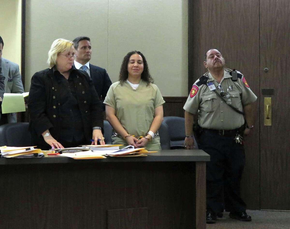 Hannah Overton, who was convicted in 2007 capital murder in the death of a child and recently had her conviction overturned by the Texas Court of Criminal Appeals, reacts as she hears Judge Mario Ramirez say that she will be granted bail during a hearing in Corpus Christi on Tuesday, Dec. 16, 2014. Her attorney, Cynthia Orr, is at left.