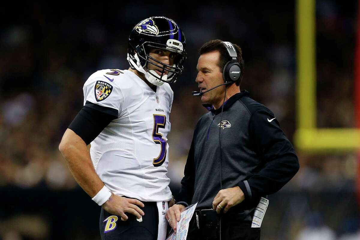 Ravens quarterback Joe Flacco speaks with offensive coordinator Gary Kubiak during the first quarter against the New Orleans Saints at the Mercedes-Benz Superdome on Nov. 24.